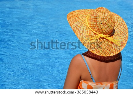 Attractive female beauty enjoying her summer vacation at swimming pool #365058443