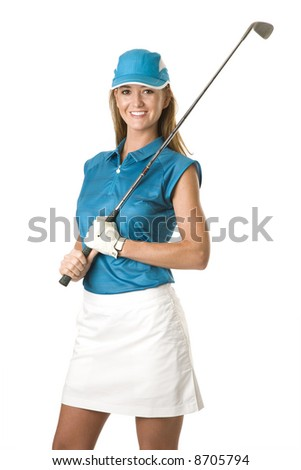 attractive female golfer in blue shirt and white shorts holding a golf club