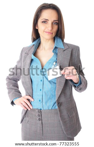 attractive female holds blank name badge, wears blue shirt and suit, isolated on white background - stock photo