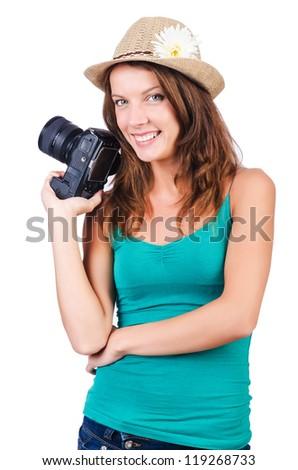 Attractive female photographer on white - stock photo