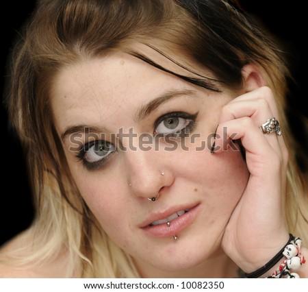 piercing under the lip. extreme female piercings. lip