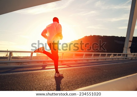 attractive fit man running fast ...