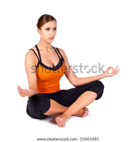 Attractive fit woman doing popular yoga pose called Easy Pose, Sanskrit name: Sukhasana, great for breath control , concentration and meditation, isolated on white background