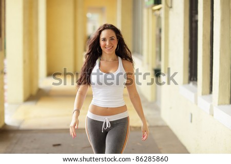 Attractive fitness model approaching the camera