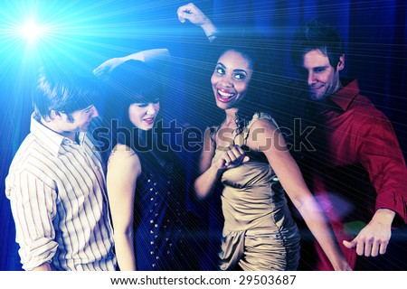 Attractive friends dancing at a night club - stock photo