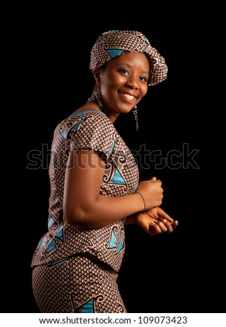 Attractive Ghanese african woman showing a dance in her traditional national costume