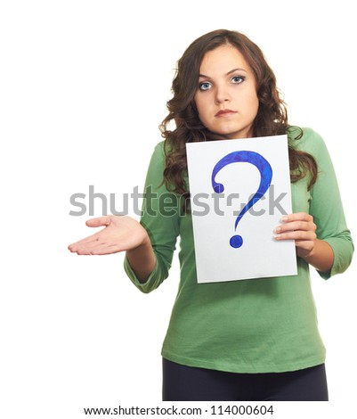 Attractive girl in a green shirt, holding a sheet of paper with a big question mark. Isolated on white background