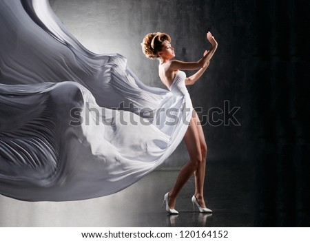 Attractive girl in fluttering white dress
