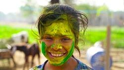 Attractive Girl in green colors Holi. Holi facial shot on spring color festival of Holi. Holi celebration concept.