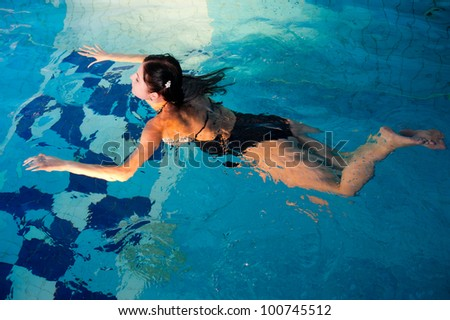 Attractive girl in swimming pool