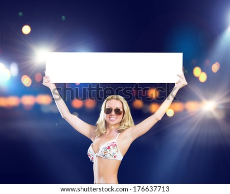 Attractive girl in swimming suit with white blank banner. Place for text
