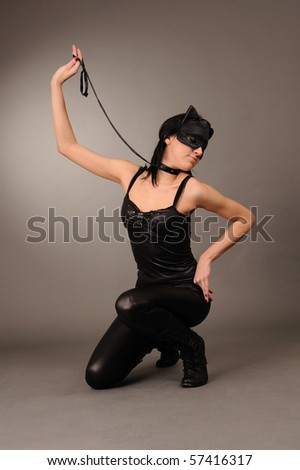attractive girl in the cat's mask, sexual role games.