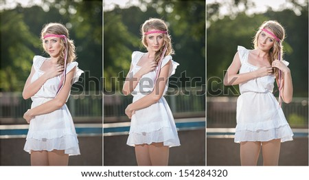 Attractive girl in white short dress sitting on parapet near the fountain in the summer hottest day.Girl with dress partly wet playing with water.Portrait of beautiful blonde women near the fountain