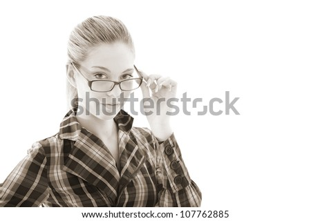 attractive girl looks through glasses. studio shot