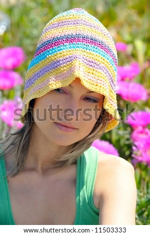 attractive girl on a field with colorful flowers
