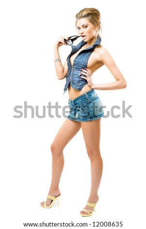 attractive girl posing in jeans outfit, isolated over white