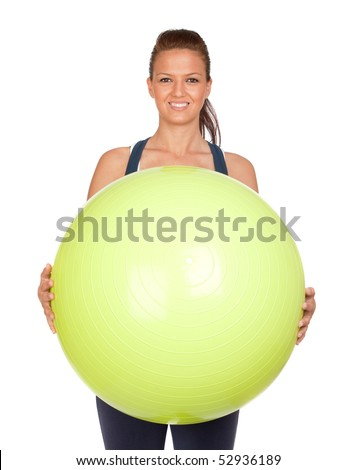 Attractive girl practicing pilates with a big green ball