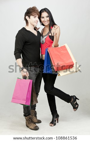 Attractive girl shopping with boyfriend