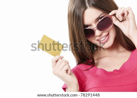 Attractive girl with a credit card on a white background