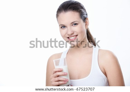 Attractive girl with a glass of milk on a white background