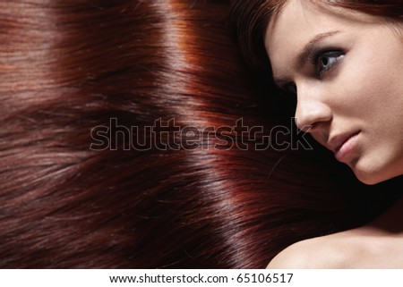 Attractive girl with beautiful healthy hair