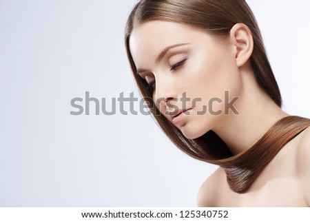 Attractive girl with hair on white background