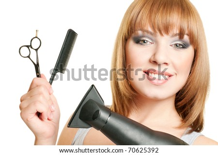 Attractive girl with hairdresser's tools isolated on white background