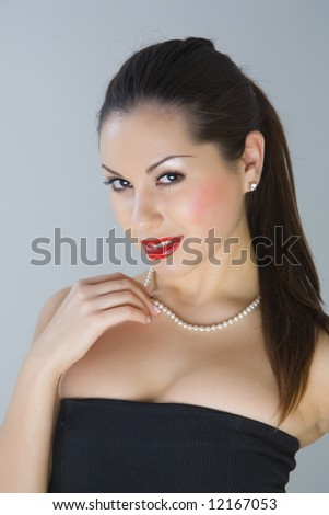 Attractive girl with necklace isolated in studio