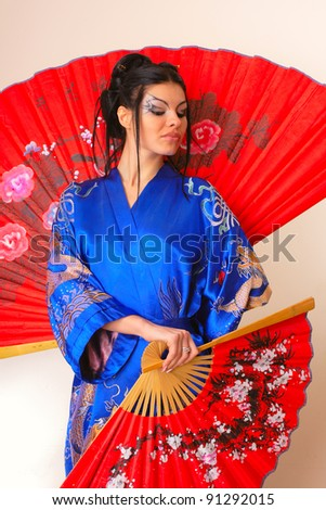 attractive girl with red asian fan