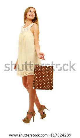 Attractive girl with shopping bag on white background