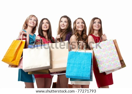 Attractive girl with shopping looking up on white background