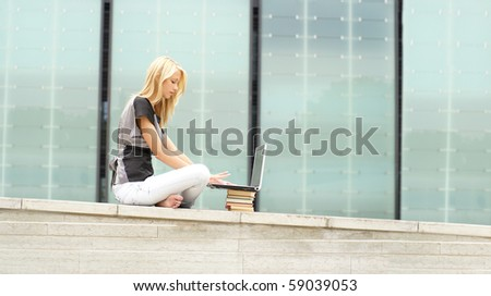 Attractive girl with the notebook