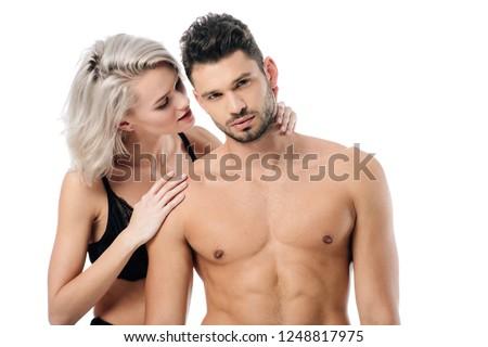 attractive girlfriend gently touching boyfriend neck isolated on white