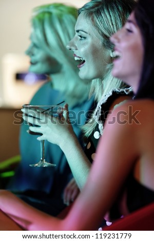 Attractive group of friends laughing and having fun in a nightclub