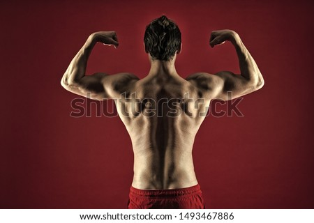 Attractive guy muscular back. Proud of excellent shape. Muscular bodybuilder concept. Healthy and strong. Macho handsome with muscular torso. Improve yourself. Man muscular athlete stand confidently.