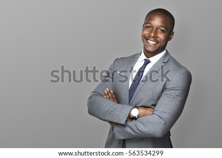 Attractive handsome happy smiling professional businessman executive with a stylish suit and tie