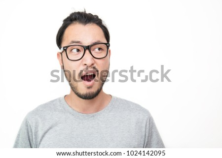 Attractive handsome shock surprise nerd man.  Close up portrait asian beard hairy nerdy man look up isolated on white background.