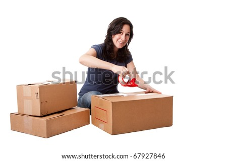 Attractive happy beautiful woman putting tape on cardboard moving storage boxes parcels preparing for mail, isolated.