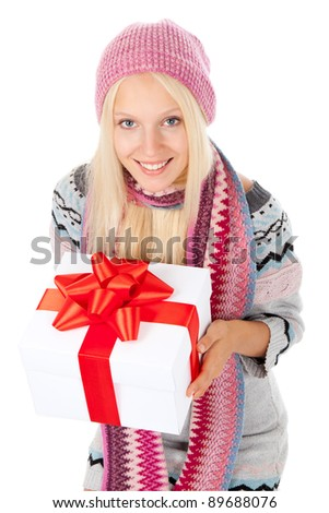 attractive happy smile young girl, hold gift box with red bow, wear winter knitted pink hat scarf and sweater, isolated over white background, looking up at camera, top angle view