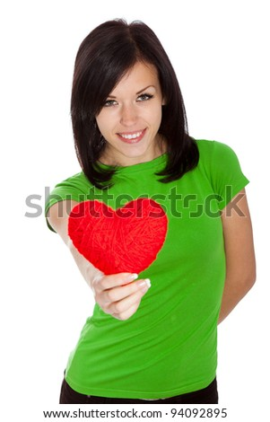 Attractive happy smiling brunette young girl holding red valentine heart; isolated on white background, concept of valentine's day
