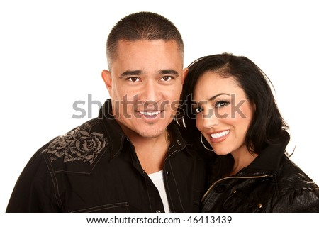 Attractive Hispanic couple in casual clothes on white background