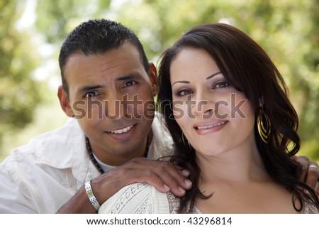 Attractive Hispanic Couple Portrait in the Park.