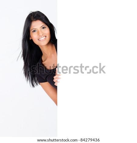 attractive hispanic woman behind blank white board