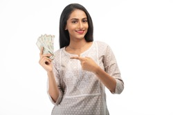 Attractive Indian Woman Pointing to Money, Against a White Background