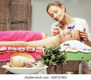 stock photo attractive lady getting spa treatment in salon, massage doctor smiling care pretty