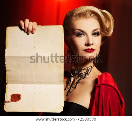 Attractive lady with an ancient document