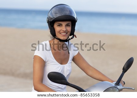 Attractive latin woman on a scooter