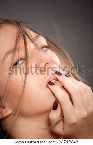 Attractive light brown hair girl cover your mouth by hand. Over black
