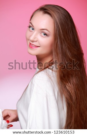 Attractive lovely girl with healthy long hair on Health care theme