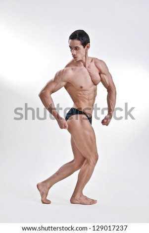 Attractive male body builder, demonstrating contest pose